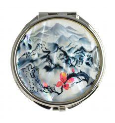 Une illustraion très élégante d'un paysge asiatique décore le miroir