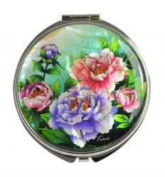 Les fleurs de pivoines colorés en nacre décore le couvercle du miroir