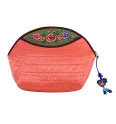 Trousse à maquillage originale rose-saumon avec broderies décoratives