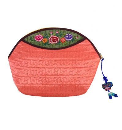 Trousse à maquillage originale rose-saumon avec broderies décoratives