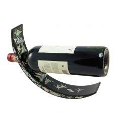 Une fois la bouteilles insérée dans le support un effet d'équilibre se met en place