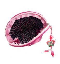 Petit porte-monnaie en tissu de couleur rose avec brodreries