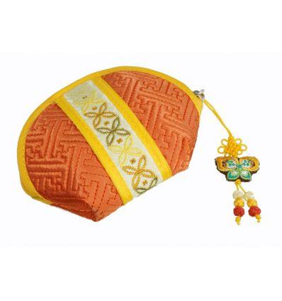 Petit porte-monnaie en tissu de couleur orange et banderolle décorative